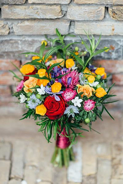 bruidsboeket oranje rood paars